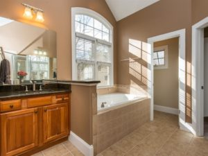 Hillman Real Estate Group - Spa-like bathroom with separate shower and tub