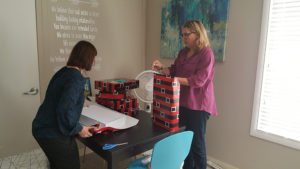 Hillman Real Estate Group team members get into the holiday spirit preparing Angel Tree gifts