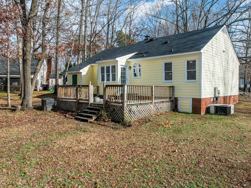 Spacious backyard and deck for enjoying the North Carolina spring, summer, and fall seasons.
