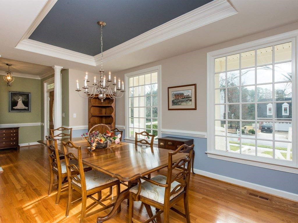 Upgraded trim and architectural features make this home shine