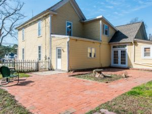A look at the exterior of this Garner homestead with expansive backyard.