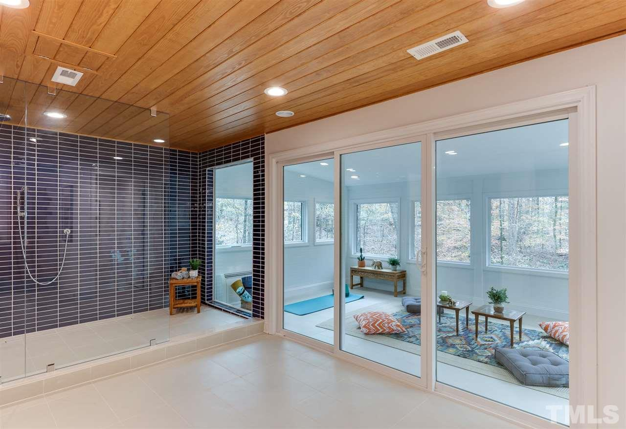3200 Doubleday Place - Modernist Home of the Month at Hillman Real Estate Group Downstairs Bathroom that Opens to Ourdoor Space