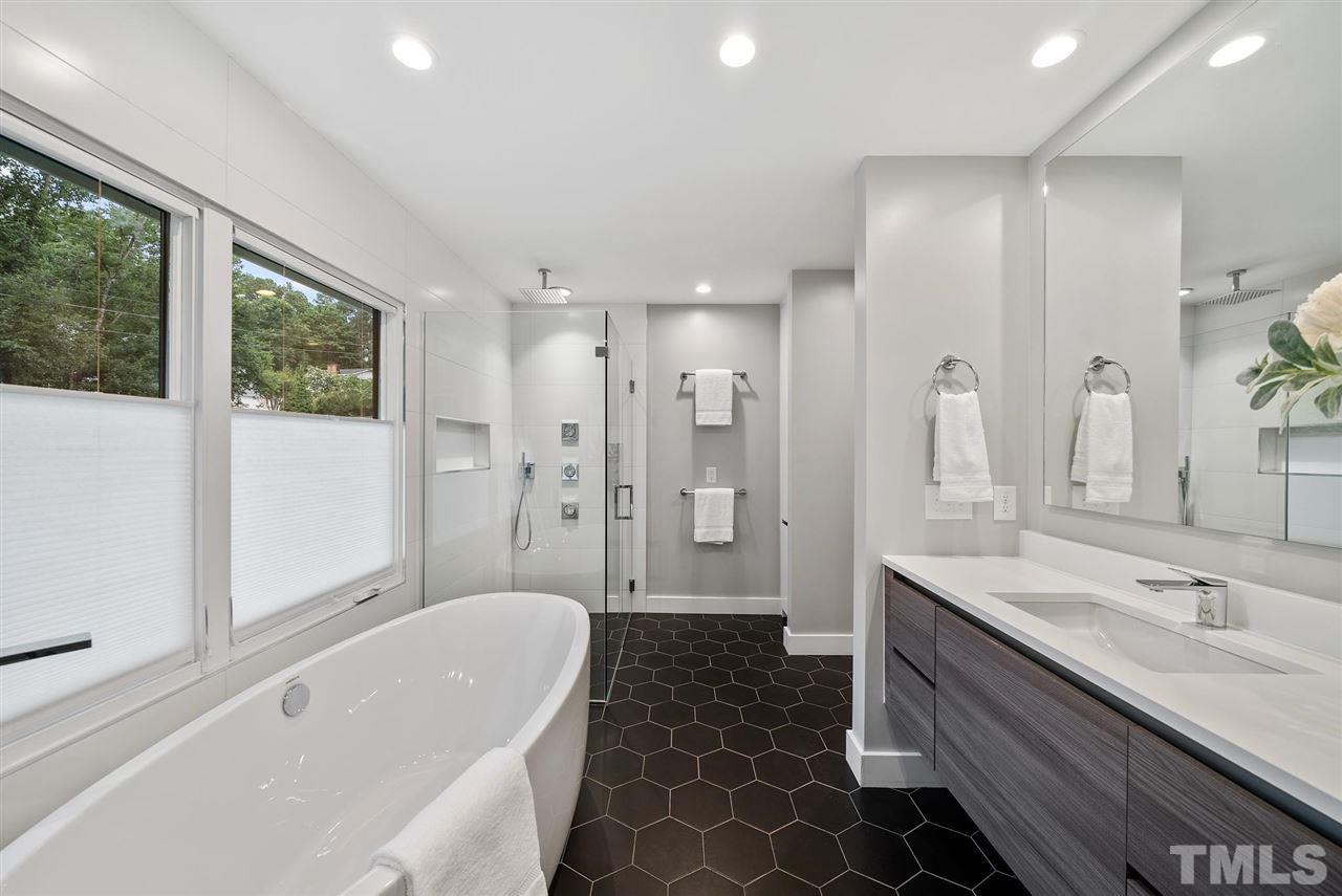 Hillman Real Estate Group's Modernist Home of the Month- 5406 Parkwood Drive Raleigh Bathroom with Tub