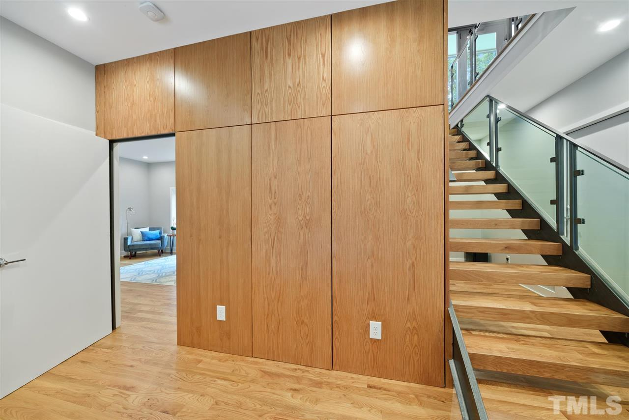 Hillman Real Estate Group's Modernist Home of the Month- 5406 Parkwood Drive Raleigh Wall and Stairs